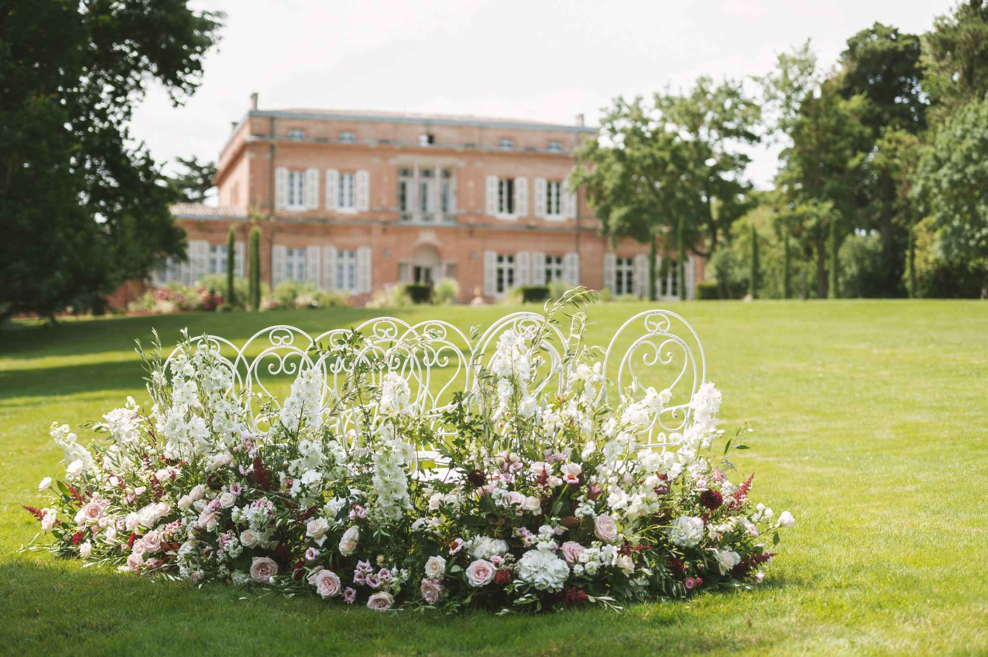 Outdoor wedding ceremony in French chateau