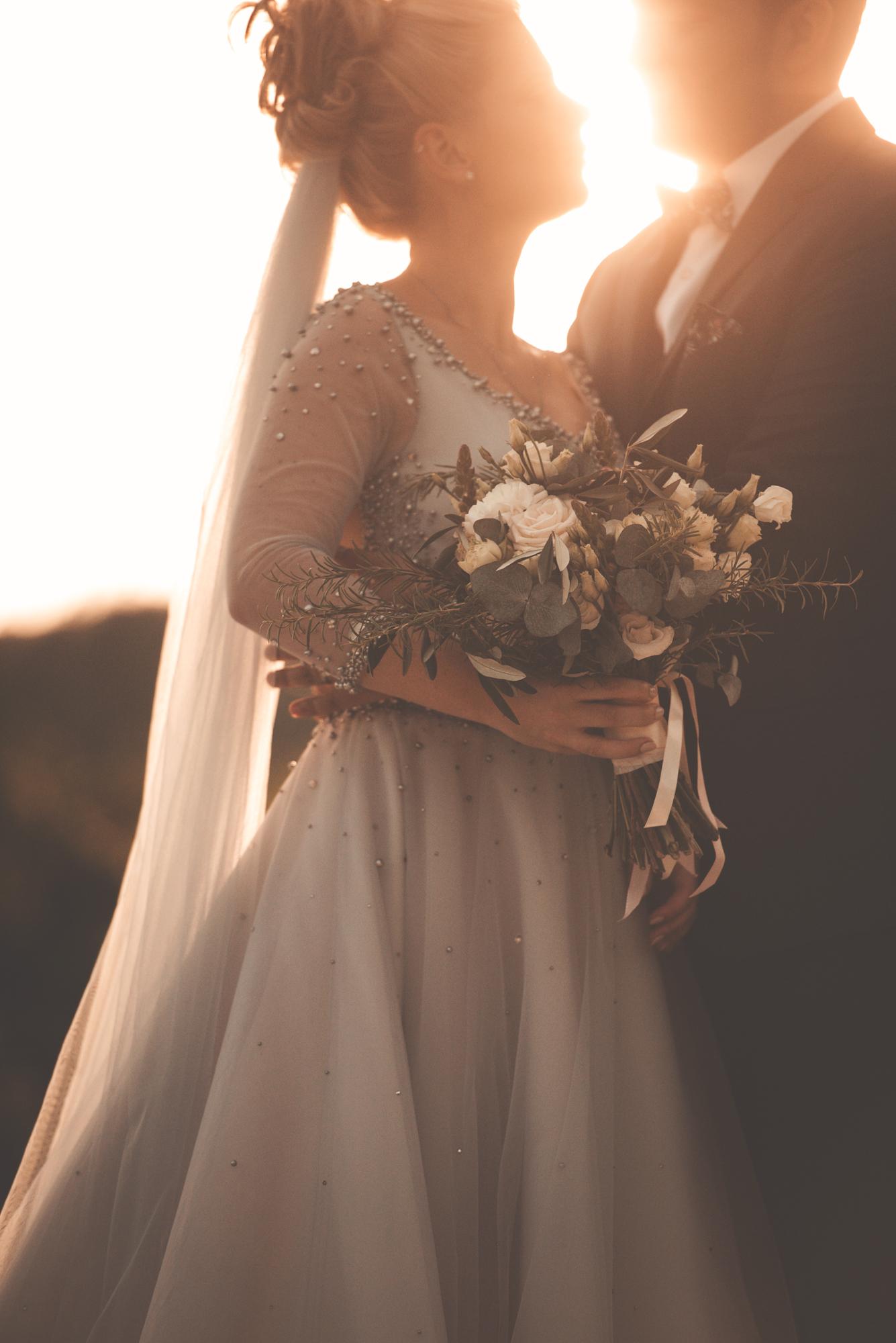Wedding couple under sunset light
