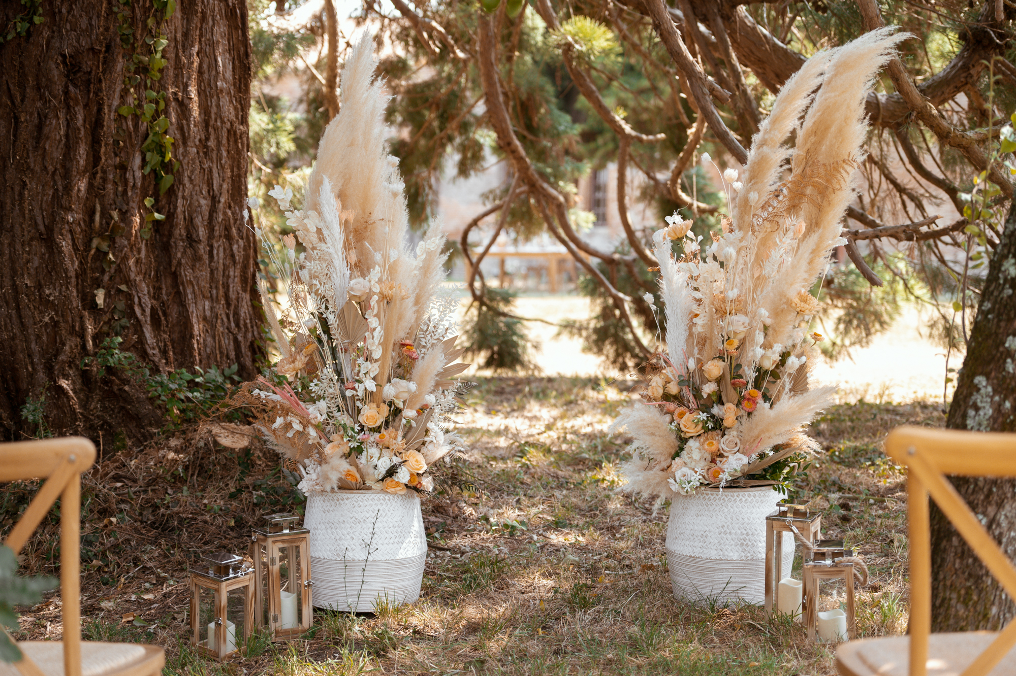 Outdoor wedding ceremony under tree