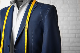 Semi-ready suit on mannequin indoors, cl