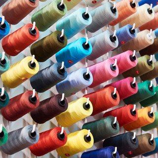 Bobbins with colored thread for industri
