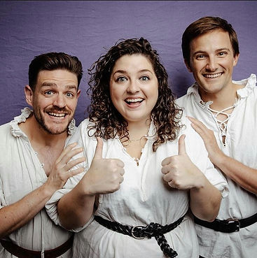 Three actors with thumbs up in Shakespearean clothes