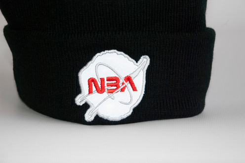 9d6f29c881d4d0 When the flash from a camera, passing car or any light for that matter hits  this applique embroidered NASA design, it gives a bright glowing effect!