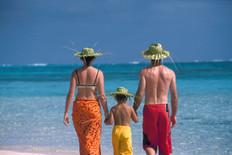 Family on Tahiti vacation walking into the lagoon
