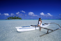 Tahitian woman in an outrigger canoe