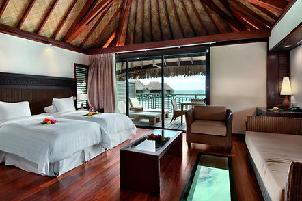 Bedroom of an overwater bungalow at the Hilton Moorea Lagoon Resort & Spa