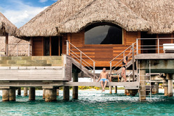 couple-overwater-bungalow-four-seasons.j