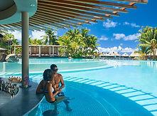 Tahiti honeymoon couple enjoying a drink at the pool bar, Conrad Bora Bora Nui