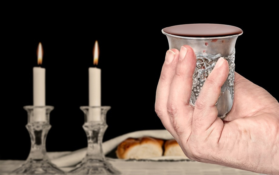 Shabbat candles, challah, and kiddush cup