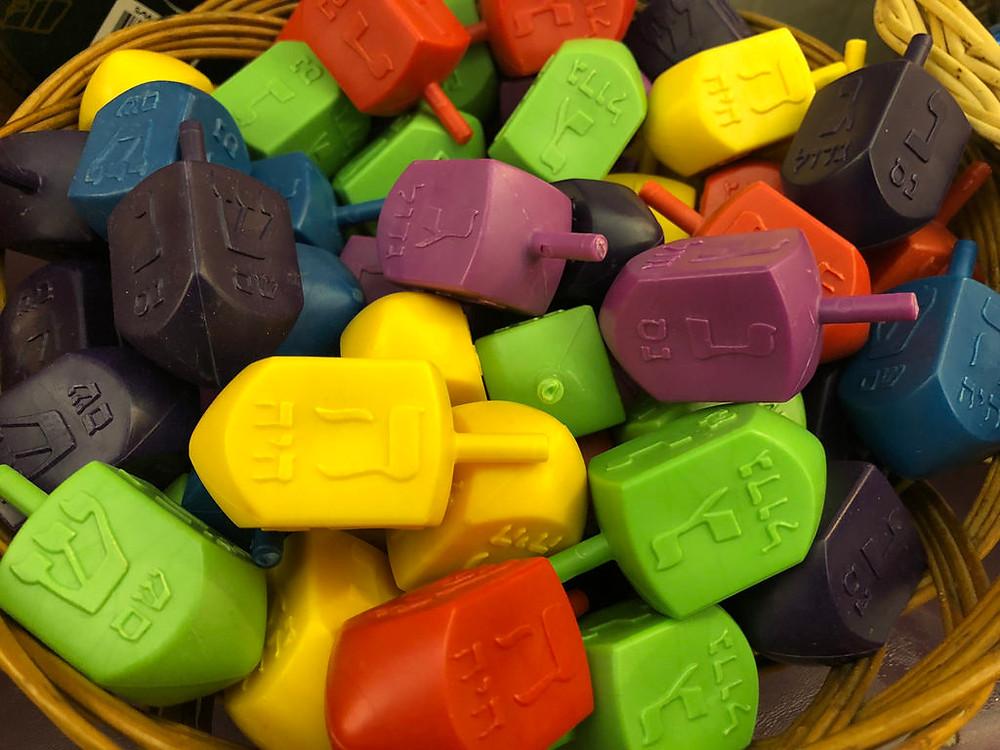 A basket full of colourful plastic dreidels