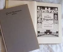 Picture of Union Haggadah and page open to ornate frontispiece.