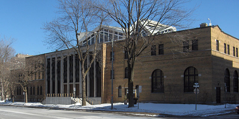 Light brick building with some arched and some tall windows - Temple Emanu-El-Beth Sholom