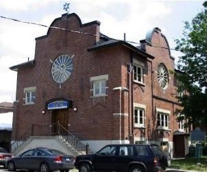 Red brick building, ornate facade.