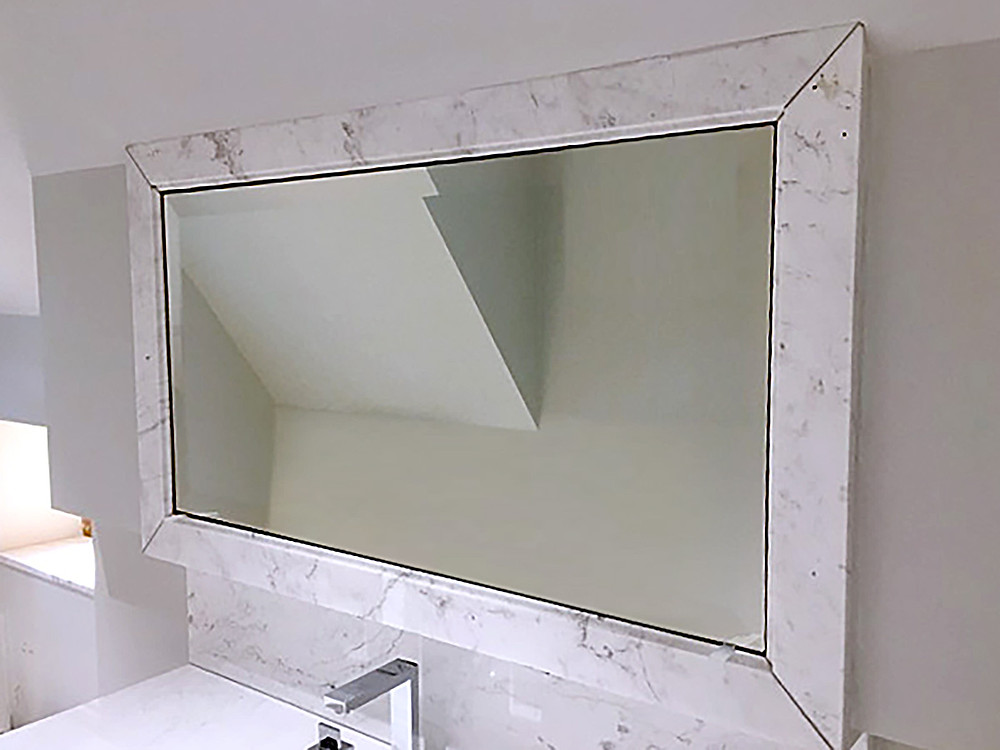 Mirror fixed to wall with marble frame