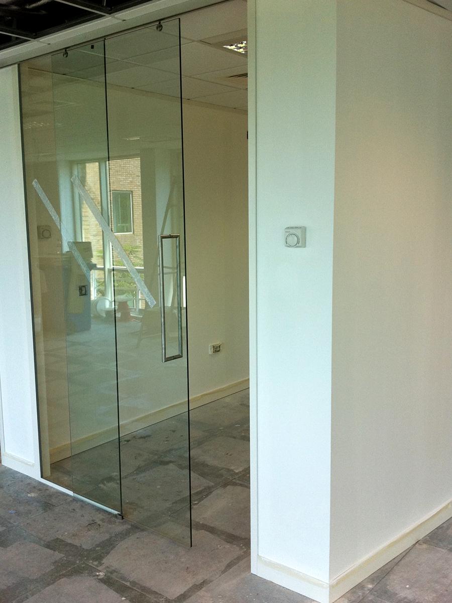 Top hung single glass sliding door
