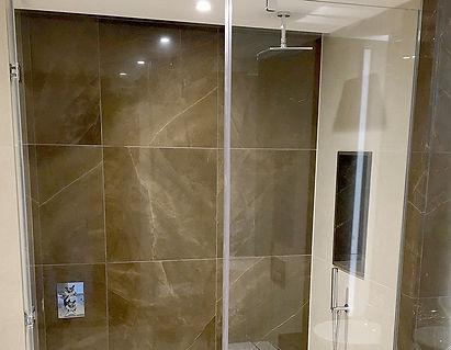 Glass shower screen and door in bathroom