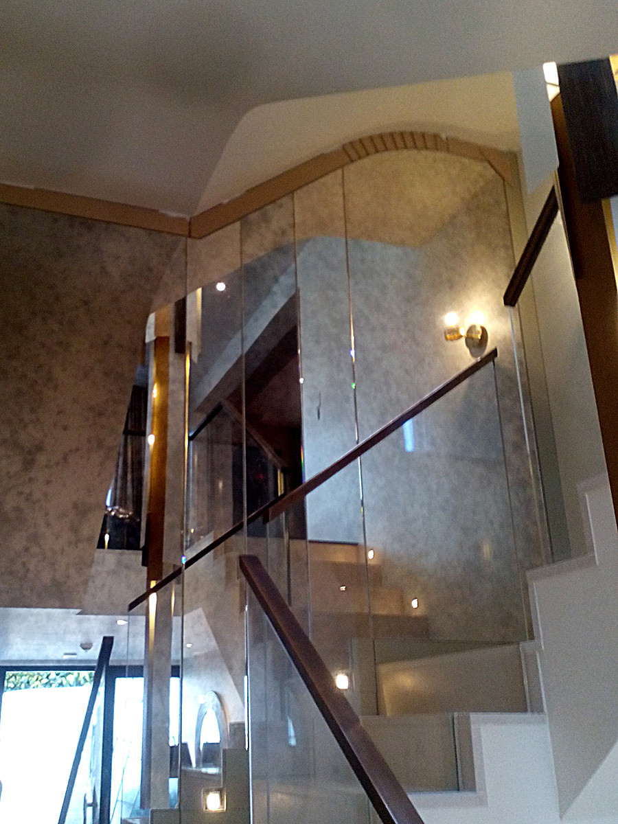 Antique style mirrors decorate staircase