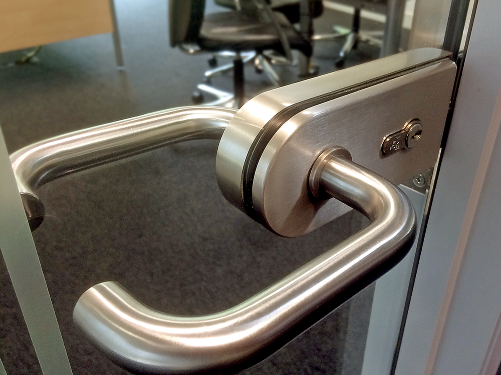 Handle and lock for a glass door