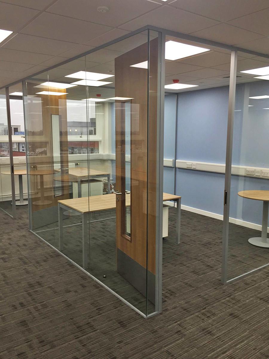 Frameless glass walls with timber doors