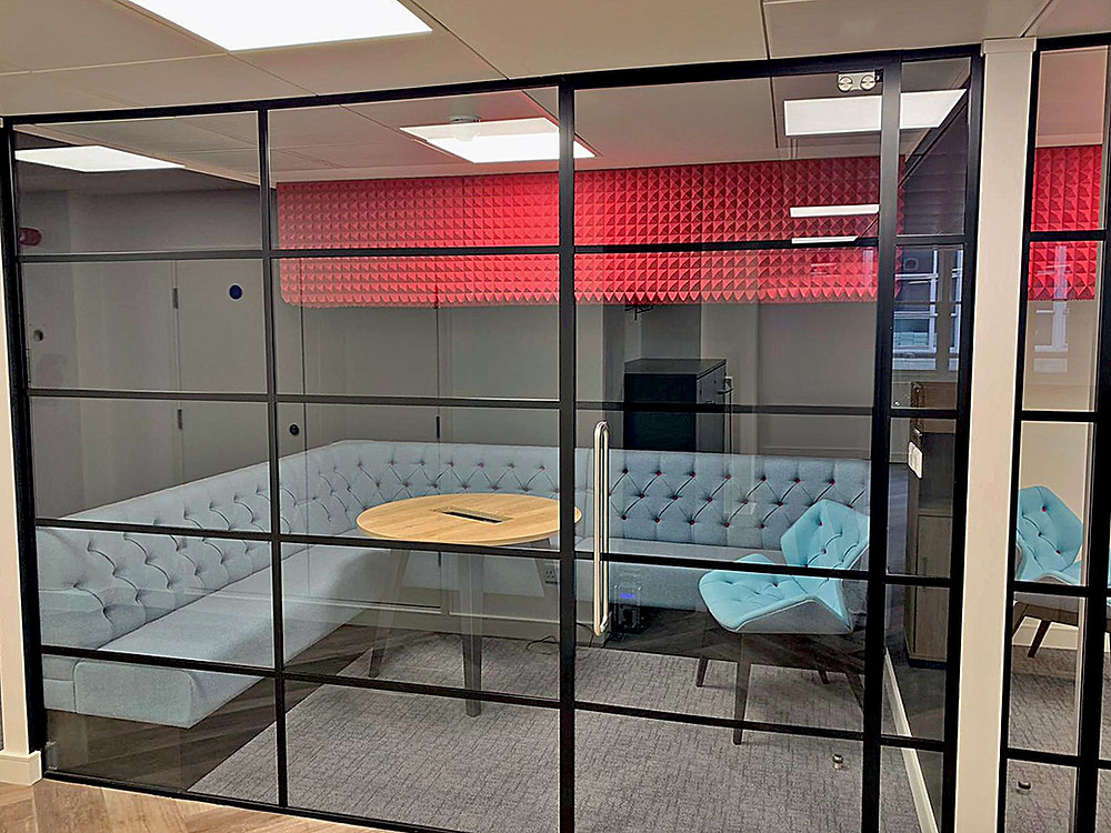 Industrial style glass partitioning in an office