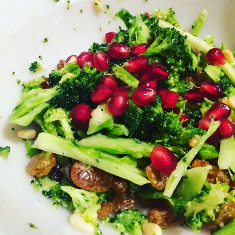 Massaged brocoli with pine nut and pomegranate