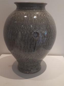 # 655 tall round stoneware vase $300 low