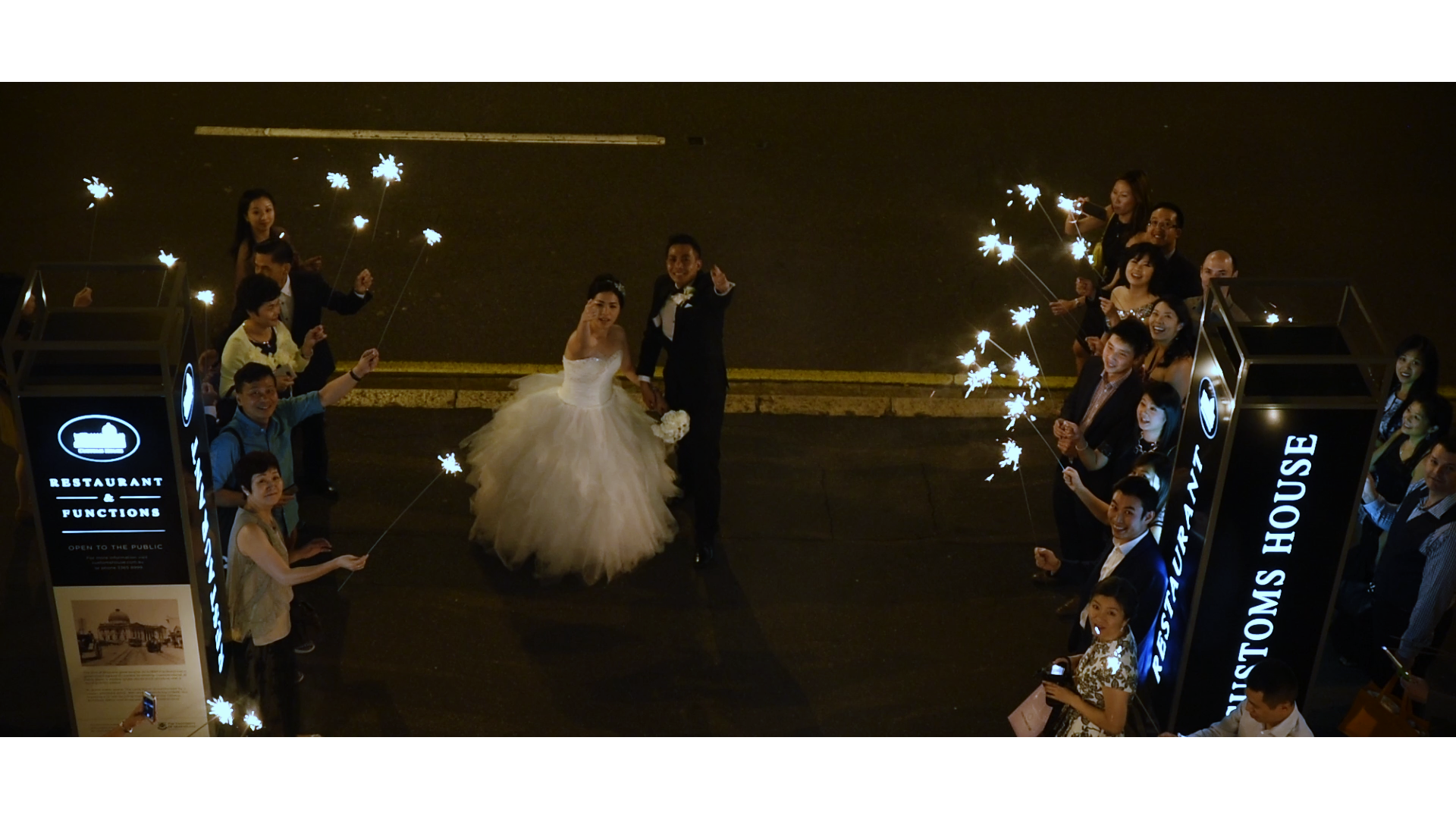 Pauline and Jack enter Customs House on the red carpet and greeted with guests waving sparklers