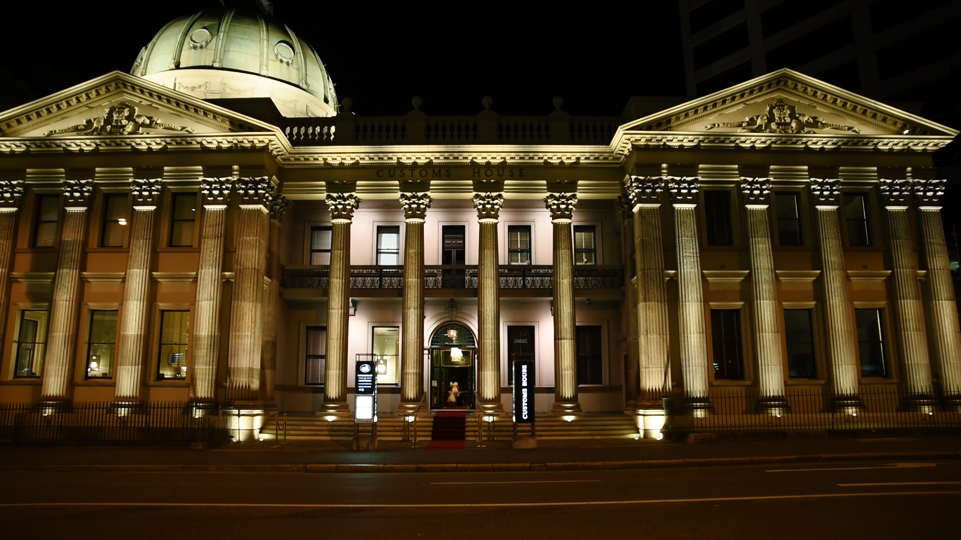 The grand Customs House lit at night