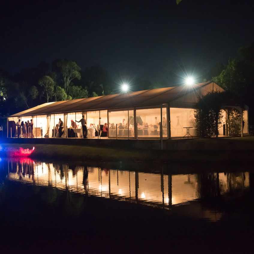 Picturesque wedding reception marquee at Cherbon Waters