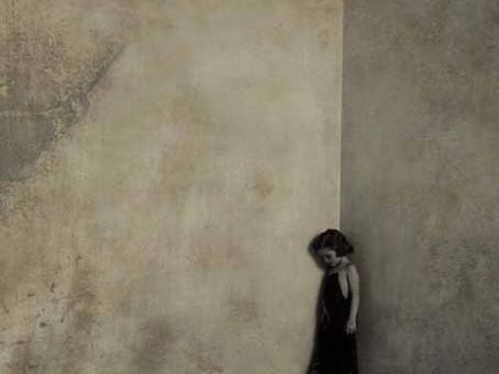 A little girl in a dark corner