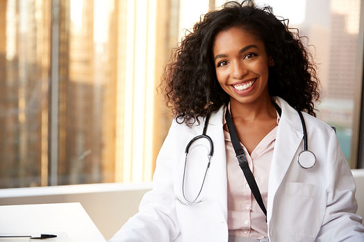 Portrait Of Smiling Female Doctor Wearin
