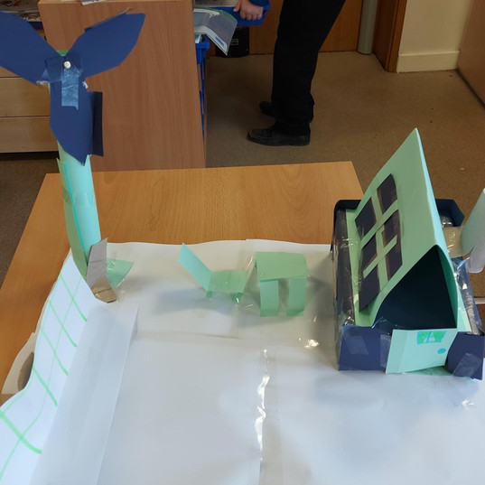 Model of wind turbine and house with solar panels