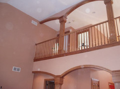Arched cased opening and handrail