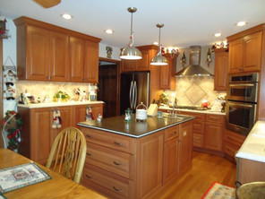 full kitchen remodel with countertops and mosiac backsplash