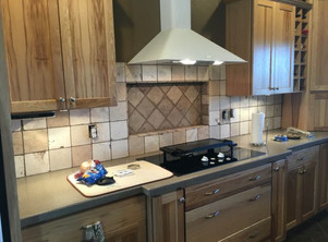 Solid surface countertop and full height backsplash on new kitchen cabinets