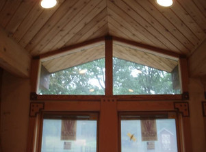 Tongue and groove ceiling and plugged window casing