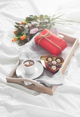 tray-with-cup-coffee-flowers-chocolates.
