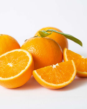 cut-whole-orange-fruits-with-green-leave