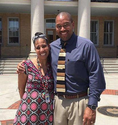 Pastor Eric Gash & his wife Katy standing outside in downtown Hendersonville, NC.