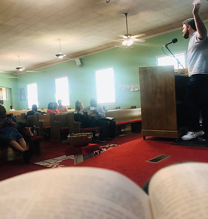 Sunday morning exhortation from First Lady Katy Gash's perspective. She took the photo from the stage where you can see her open Bible, the speaker, and the crowd listening to the speaker.