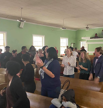 Sunday morning worship and everyone is singing, clapping, and smiling