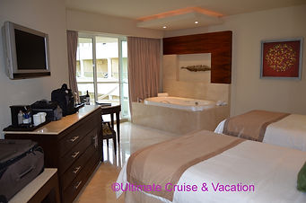 Moon Palace room with Jacuzzi. balcony, and 2 beds.