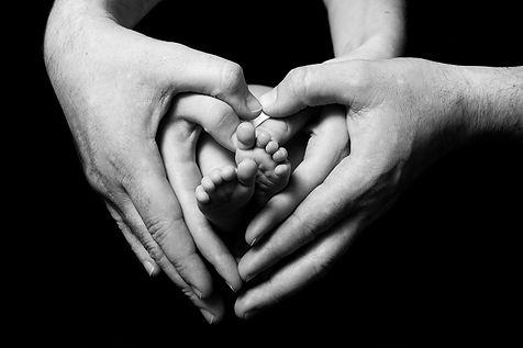 newborn-babies-feet-in-parents-hands.jpg