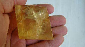 a square gold-yellow gemquartz stone