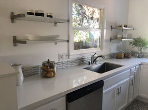 White modern kitchen, small space, white quartz countertops, glass tile backsplash, open shelving, stainless farmhouse sink, country tile flooring, Venice, CA