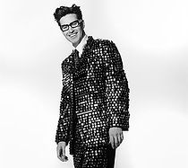 A man wearing a sequin suit stands out in a crowd just like my direct mail copywriting will make your company stand out from the crowd