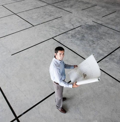 New office guy with plan.jpg