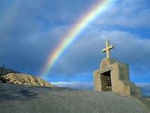 rainbow over burial cross grave