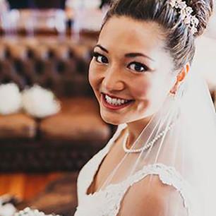 High bun Hair up and  Natural Bridal Makeup