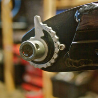 snail-cam chain tensioner